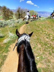 A first person view of horseback riding at Rankin during a ranch getaway.