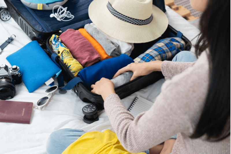 A woman packing for a trip.